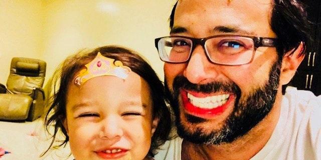 RabbiShlomo Zalman (Sam) Bregman with one of his daughters, playing inside because of the coronavirus outbreak.