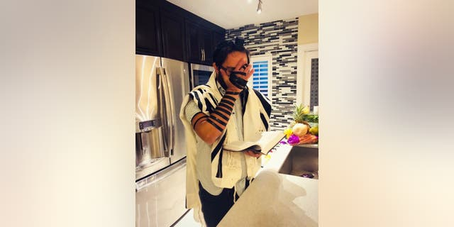RabbiShlomo Zalman (Sam) Bregman doing prayer service at home because the synagogues are closed.