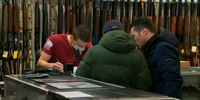 Individual completes the necessary paperwork to purchase a firearm.