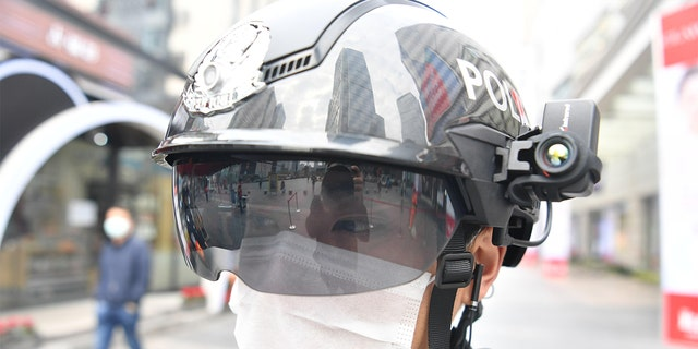 A police officer wearing a smart helmet stands guard at Chunxi Road on March 7, 2020 in Chengdu, Sichuan Province of China.
