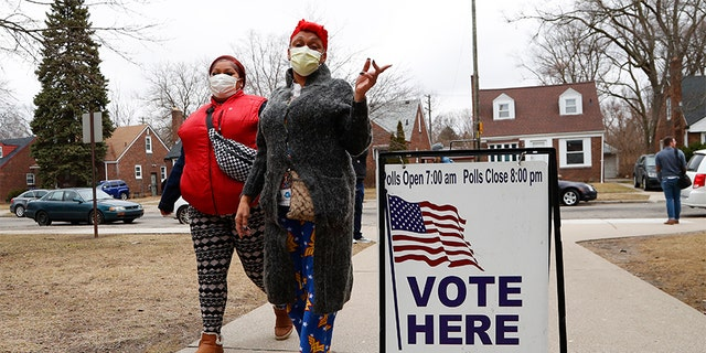 Voters arrive with masks in light of the coronavirus COVID-19 health concern at Warren E. Bow Elementary School in Detroit, Tuesday, March 10, 2020. (Associated Press)
