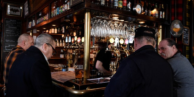 People gather for a drink at the Half Way In pub, as bars and restaurants are still open despite the coronavirus disease (COVID-19) outbreak, in central Stockholm, Sweden.