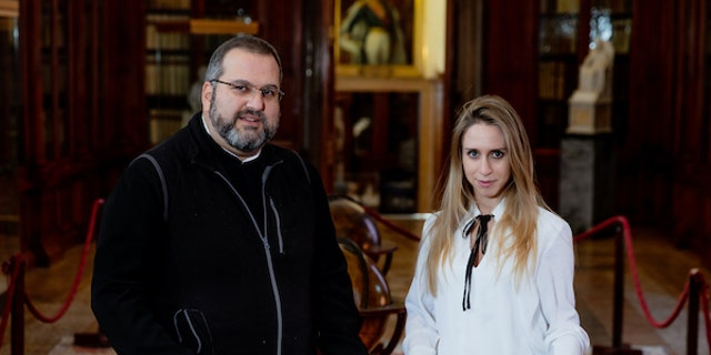 Father Serafino Jamourlian and Vittoria Dall'Armellina with the sword. (Photo credit: Andrea Avezzù/Ca' Foscari University of Venice)