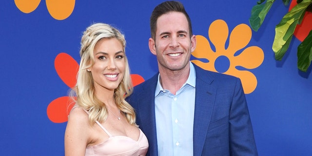 "Tarek El Moussa (R) and Heather Rae Young (L) attend the premiere of HGTV's ""A Very Brady Renovation"" at The Garland Hotel on September 05, 2019, in North Hollywood, Calif. (Photo by Rachel Luna/Getty Images)"