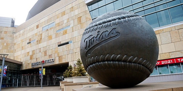 A giant baseball sculpture sits outside Target Field, home of the Minnesota Twins baseball team, Wednesday, March 25, 2020 in Minneapolis. Though the Twins would open on the road, the start of the regular season is indefinitely on hold because of the coronavirus pandemic. (AP Photo/Jim Mone)