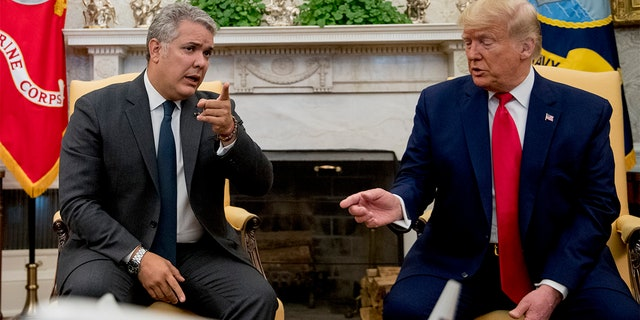 President Donald Trump meets with Colombian President Ivan Duque, left, in the Oval Office of the White House, Monday, March 2, 2020, in Washington.