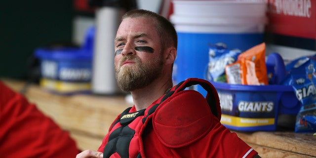 As Major League Baseball and the players' union consider various ways to try to schedule things once the coronavirus pandemic subsides, Reds catcher Tucker Barnhart raised a concern that is surely shared by others around the sport: Could trying to cram in games, and maybe extend the season into late November or December, lead to injuries? (AP Photo/Ross D. Franklin File)