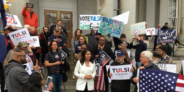 Democratic presidential candidate Rep. Tulsi Gabbard joins supporters after filing to place her name on New Hampshire's presidential primary ballot, in Concord, NH in Nov. 2019.
