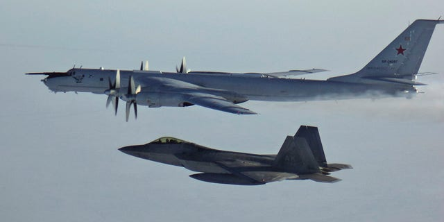 In this Monday, March 9, 2020 photo released by the North American Aerospace Defense Command (NORAD), a Russian Tu-142 maritime reconnaissance aircraft, top right, is intercepted near the Alaska coastline. U.S. and Canadian aircraft intercepted and escorted two Russian jets that flew over the Beaufort Sea near the Alaska coastline, military officials said Tuesday.
