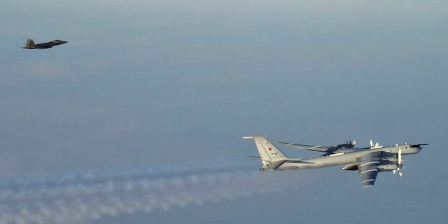 A Russian jet, pictured right, came as close as 50 miles to the Alaskan coast, according to officials.(North American Aerospace Defense Command via AP)