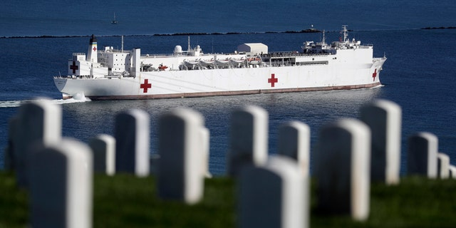The USNS Mercy hospital ship leaves port Monday, in San Diego.