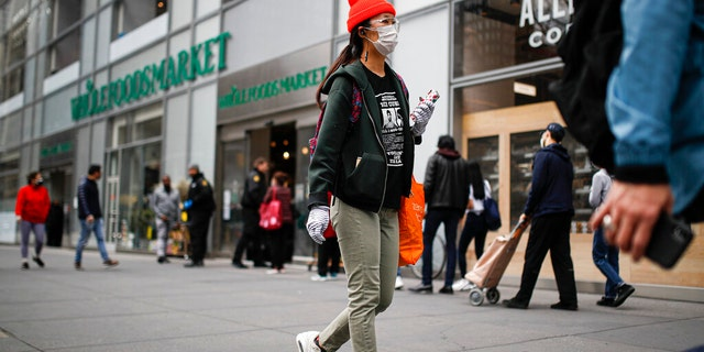 """Whole Worker, a """"grassroots movement"""" aiming to organize Whole Foods workers, is asking the company's employees not to show up to work on March as part of a planned """"sick out."""" (AP Photo/John Minchillo)"""