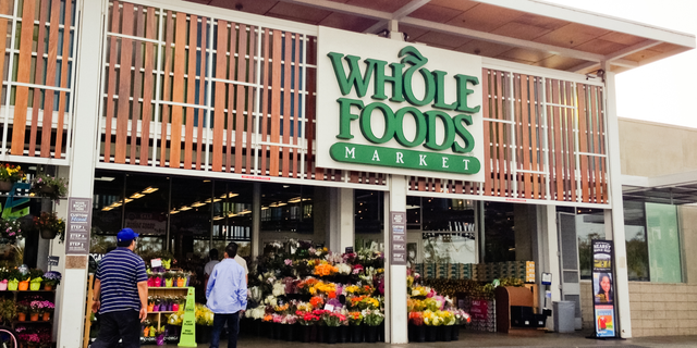 Amazon is offering warehouse workers higher pay if they'll agree to pack groceries at Whole Foods Market.
