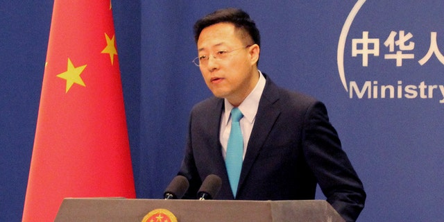 Chinese Foreign Ministry spokesman Zhao Lijian during his first regular press briefing at the Chinese Foreign Ministry on Feb. 24, 2020. He has been the tip of the spear in China's coronavirus disinformation campaign. (Photo by Roman BalandinTASS via Getty Images)