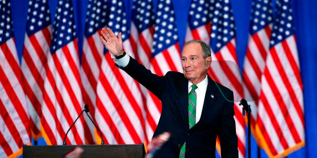 Former Democratic presidential candidate Mike Bloomberg waves to supporters as he announces the suspension of his campaign and his endorsement of former Vice President Joe Biden for president in New York Wednesday, March 4, 2020. (AP Photo/Eduardo Munoz Alvarez)