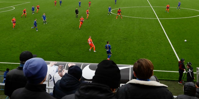 In this photo taken on Thursday, March 19, 2020, football fans watch the Belarus Championship soccer match between Energetik-BGU and Bate in Minsk, Belarus. (AP Photo/Sergei Grits)