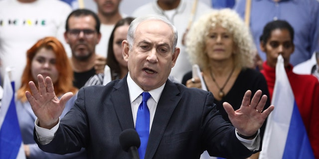 Israeli Prime Minister and head of the Likud party Benjamin Netanyahu delivers a statement in Petah Tikva, Saturday, March 7, 2020. (AP Photo/Oded Balilty)