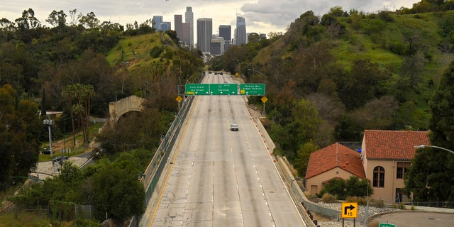 In this March 20, 2020 file photo, extremely light traffic moves along the 110 Harbor Freeway toward downtown mid afternoon, in Los Angeles.