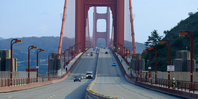 Light traffic is seen on the evening commute over the Golden Gate Bridge on Friday, March 27, 2020, in Sausalito, Calif.