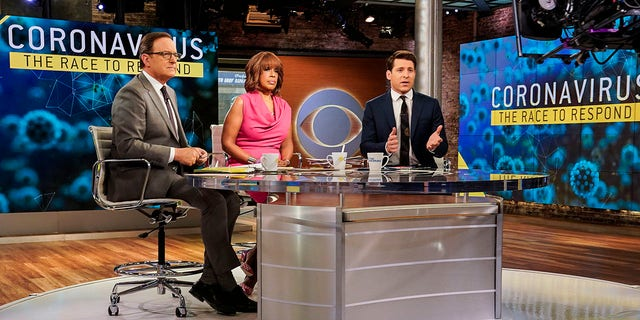 """CBS This Morning"" hosts Anthony Mason, left, Gayle King and Tony Dokoupil reporting on the coronavirus, March 6, 2020. (Michele Crowe/CBS via AP)"