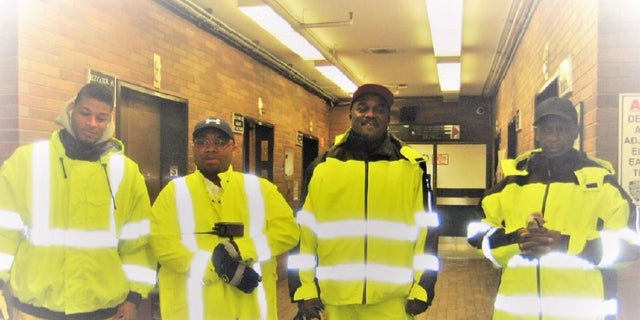 This photo show Dennis Dickson, third from the left, during the cleanup of Superstorm Sandy in 2012. Dickson, a custodian with the New York Police Department, became the agency's first employee to die from the coronavirus, the NYPD said Thursday.