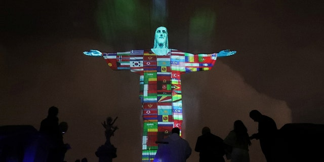 The statue of Christ the Redeemer is lit up in the colors of the countries that are affected by the coronavirus disease (COVID-19) outbreak in Rio de Janeiro, Brazil, March 18, 2020.