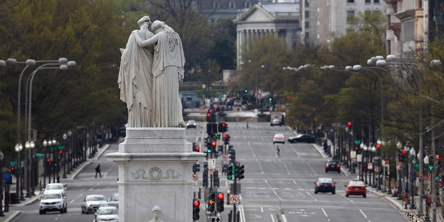 The Peace Monument faces a quiet Pennsylvania Avenue Northwest at rush hour, Monday, March 30, 2020, in Washington D.C.