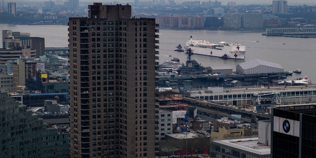 The Navy hospital ship USNS Comfort moves along the Hudson River before docking in New York, Monday, March 30, 2020.