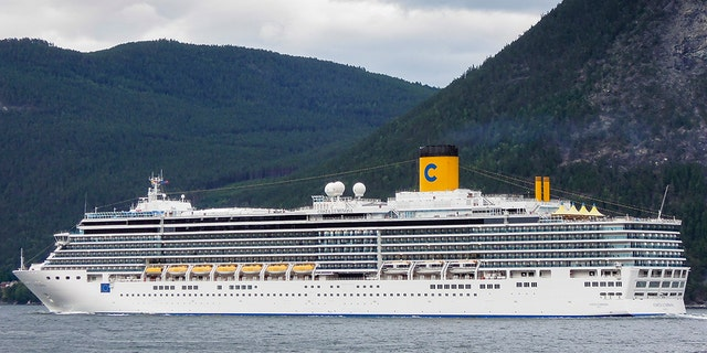 Leikanger, Norway - August 8, 2012: Costa Luminosa cruise ship sailing through the Sognefjord near the town of Leikanger in Norway.