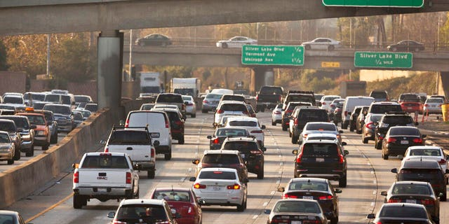 The Trump administration is rolling back tough Obama-era mileage standards and gutting one of the United States' biggest efforts to slow climate change. The administration released its relaxed mileage rules Tuesday. (AP Photo/Damian Dovarganes, File)