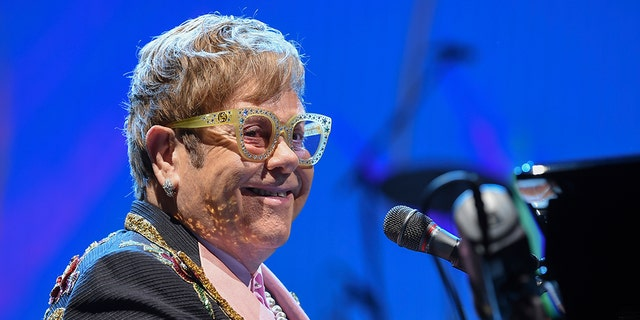 """Singer/songwriter Elton John performs onstage during his """"Farewell Yellow Brick Road"""" final tour at Madison Square Garden on Thursday, Oct. 18, 2018, in New York. (Photo by Evan Agostini/Invision/AP)"""