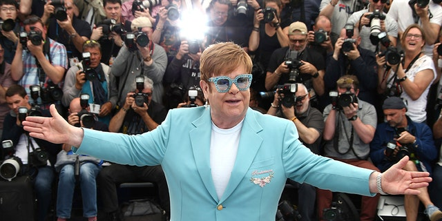 Elton John poses for photographers at the photo call for the film 'Rocketman' at the 72nd international film festival, Cannes,