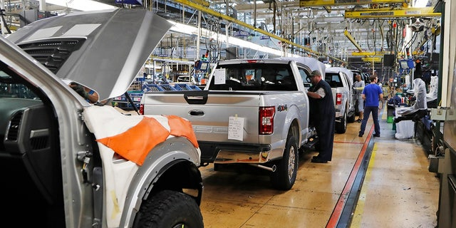 United Auto Workers assembly workers assemble 2018 Ford F-150 trucks at the Ford Rouge assembly plant in Dearborn, Mich., Sept. 27, 2018. (Associated Press)
