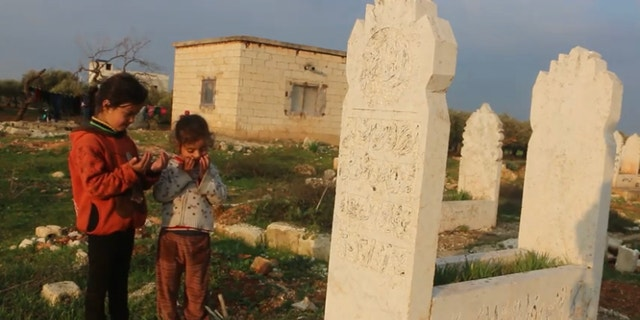 A family lives in a graveyard in Idlib, the last rebel stronghold in the Syrian Civil War