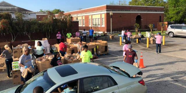 Community Warriors passed out food Saturday in Phenix City, Alabama.