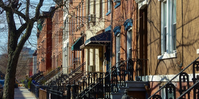 Row of houses and sidewalk in the city of Hoboken, New Jersey. (iStock)