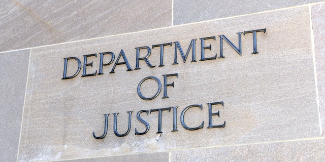 Department of Justice sign, Washington, D.C. Many law enforcement agencies are administered by the DOJ, including the FBI, DEA and Federal Bureau of Prisons
