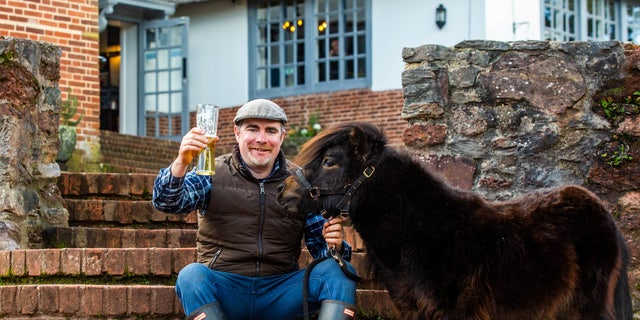 Around 100 people were scheduled to attend a village pub to mark the second birthday of the stout-loving Shetland named Patrick, pictured, on St Patrick's Day.