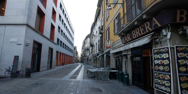 A deserted street at the Brera artistic district in Milan, Italy, Wednesday, March 11, 2020. Italy is mulling even tighter restrictions on daily life and has announced billions in financial relief to cushion economic shocks from the coronavirus. For most people, the new coronavirus causes only mild or moderate symptoms, such as fever and cough. For some, especially older adults and people with existing health problems, it can cause more severe illness, including pneumonia.
