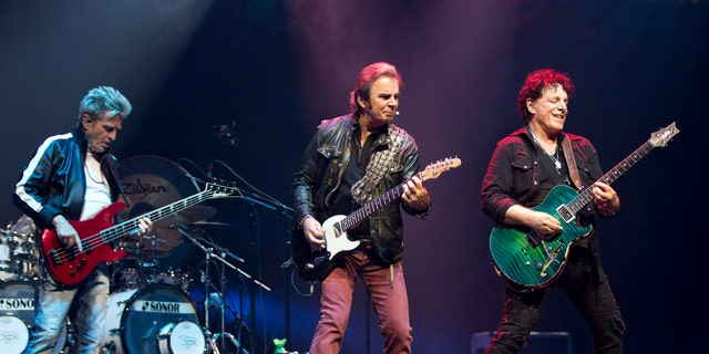 Bassist Ross Valory, keyboardist Jonathan Cain, and founder and guitarist Neal Schon of the band Journey are seen at Prudential Center on June 15, 2018 in New Jersey.