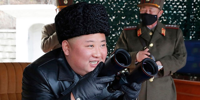 In this photo provided by the North Korean government, North Korean leader Kim Jong Un inspects a military drill at undisclosed location in North Korea on Monday, March 2, 2020. (Korean Central News Agency/Korea News Service via AP)