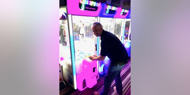 Owner Rob Braddick, pictured, at a new and improved claw machine atHo Barts Amusement Arcade in Devon, England.