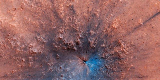 A recent impact crater on Mars. (NASA/JPL-Caltech/University of Arizona)