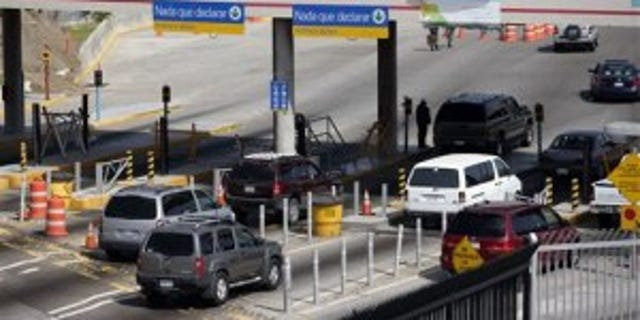 Cars crossing at the U.S.-Mexico border.