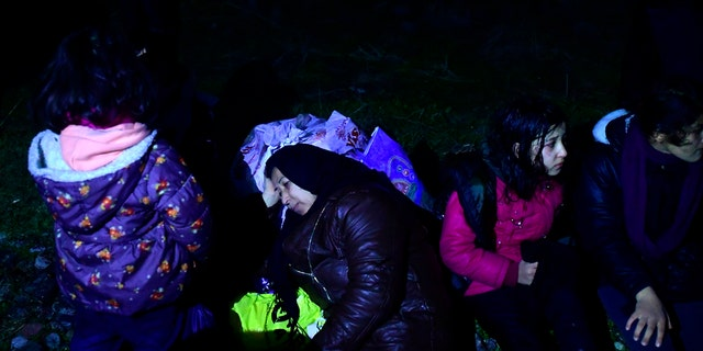 Migrants arrive at the village of Skala Sikaminias, on the Greek island of Lesbos, after crossing on a dinghy the Aegean sea from Turkey, Sunday, March 1, 2020.