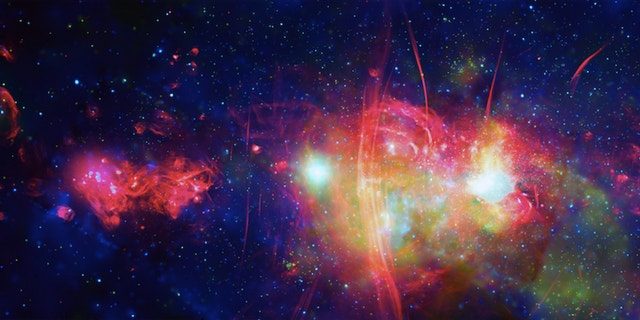 This image released by NASA depicts the Milky Way galaxy's center. (X-Ray:NASA/CXC/UMass/D. Wang et al.; Radio:NRF/SARAO/MeerKAT)