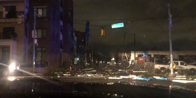Debris scattered across an intersection Tuesday, March 3, 2020, in downtown Nashville, Tenn. The National Weather Service in Nashville confirmed a tornado touched down in the area.