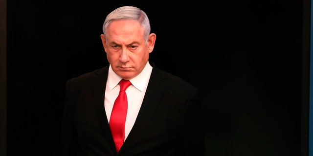 Israeli Prime Minister Benjamin Netanyahu is going into self-quarantine after an aide tested positive for the coronavirus, his office confirmed Monday to Fox News.