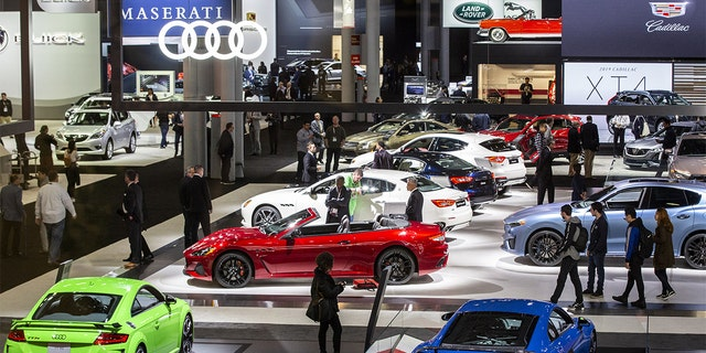 Attendees walk through the exhibition floor of the 2019 New York International Auto Show (NYIAS) in New York, U.S., on Thursday, April 18, 2019. The NYIAS, North America's first and largest-attended auto show dating back to 1900, showcases an incredible collection of cutting-edge design and extraordinary innovation. (Natan Dvir/Bloomberg via Getty Images)