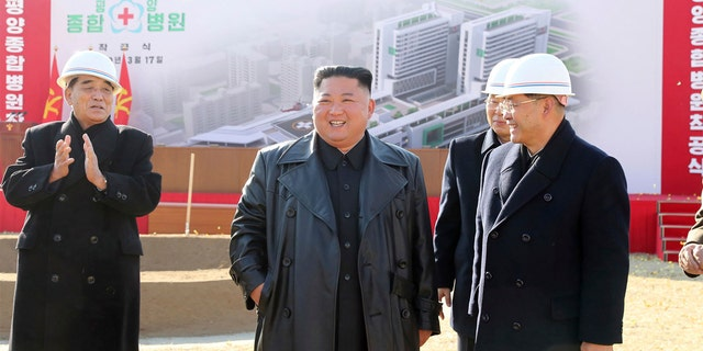 In this March 17 photo provided by the North Korean government, North Korean leader Kim Jong Un, center, attends the ground-breaking ceremony of a general hospital in Pyongyang, North Korea.